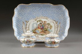 A MEISSEN PARCEL GILT AND COLORFULLY PAINTED DESK SE