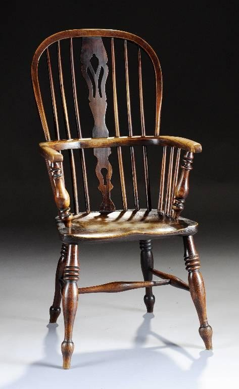 7: A WINDSOR BOW-BACK OAK ARMCHAIR, the arched crest ra