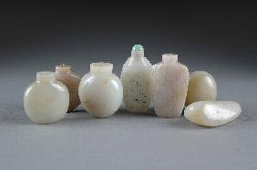 18: A COLLECTION OF EIGHT CHINESE CARVED JADE SNUFF BOT