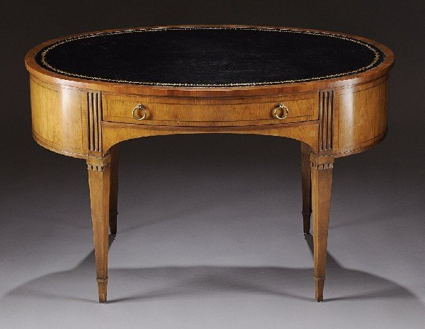10: A NEOCLASSICAL STYLE WALNUT OVAL DESK, LATE 20TH CE