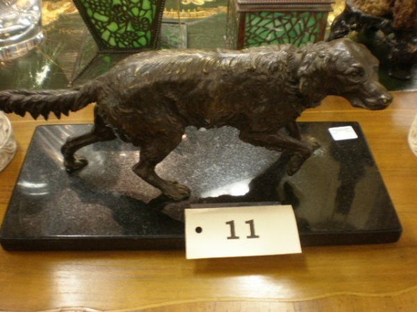 11: A FRENCH PATINATED BRONZE SCULPTURE OF A DOG cast s