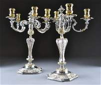 256: A PAIR OF ASPREY STERLING SILVER FOUR LIGHT CANDEL