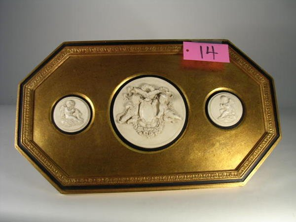 14: An Italian gilt-metal frame with canted corners cen