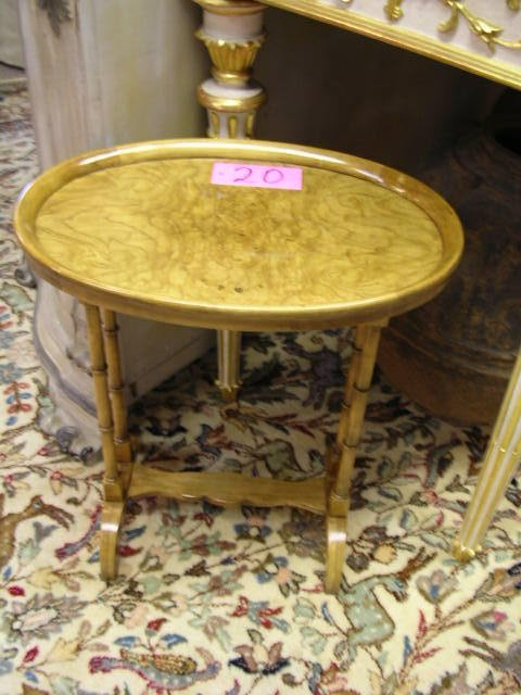 20: A burled olive wood occasional table by Baker, the