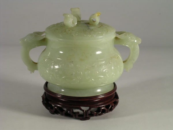 165: An antique Chinese carved jade covered bowl, the s