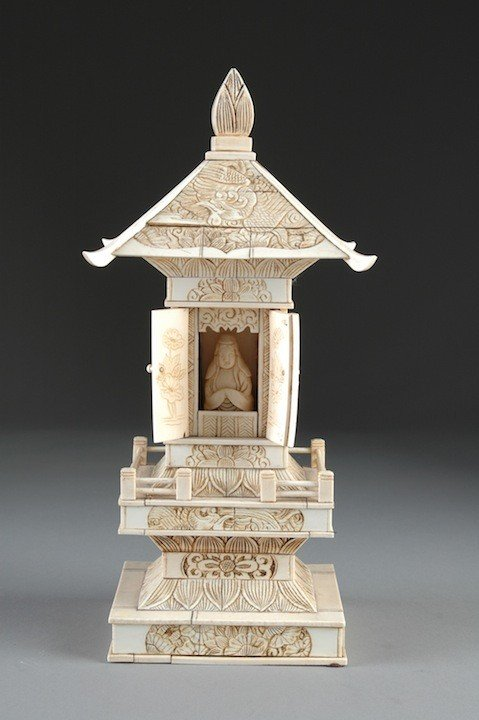 9: A QING DYNASTY CARVED BONE SHRINE, the pagoda roof s