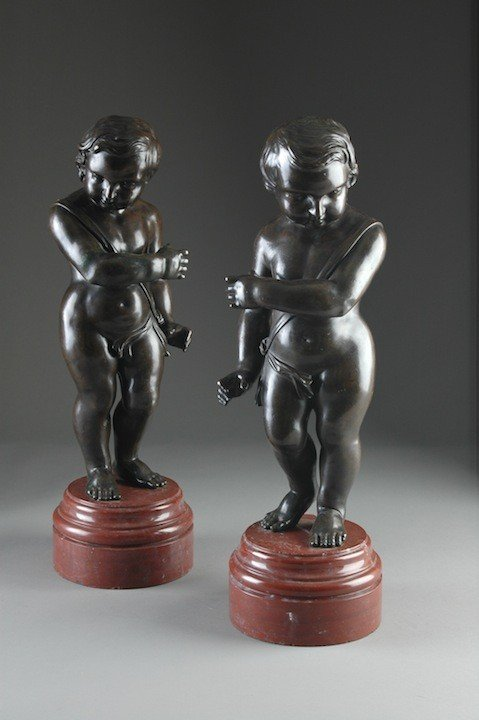 17: A PAIR OF NAPOLEON III PATINATED BRONZE FIGURES OF