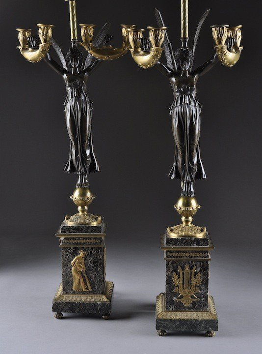 21: A PAIR OF EMPIRE STYLE GILT AND PATINATED BRONZE FO