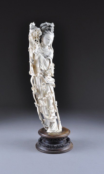 84: A CHINESE CARVED IVORY FIGURE OF QUAN YIN, the godd