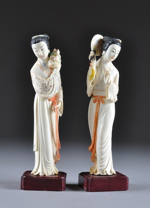 143: A PAIR OF CHINESE CARVED POLYCHROMED IVORY FIGURES