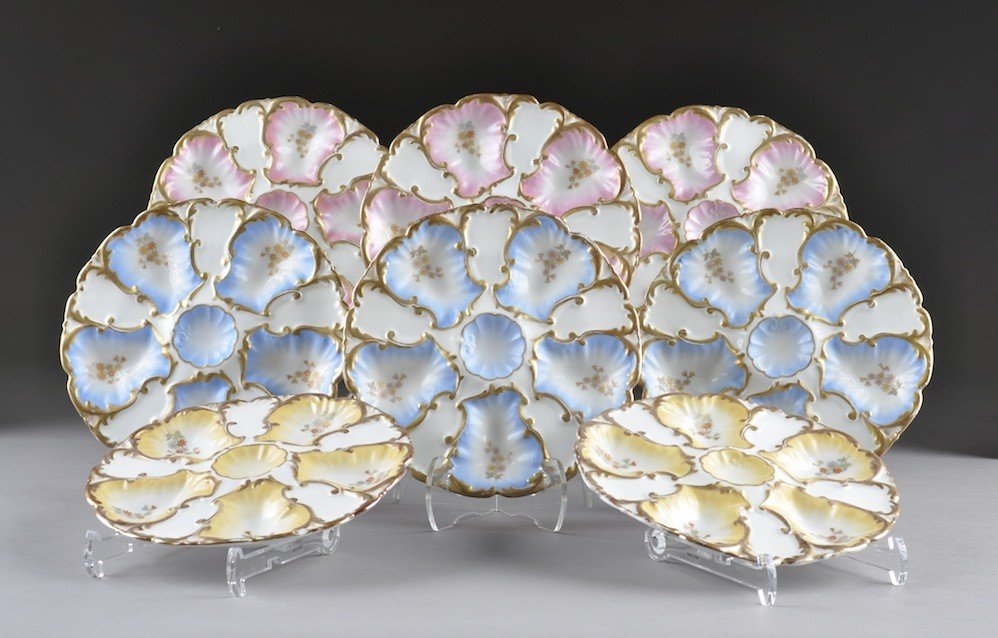 7: A SERVICE OF EIGHT LIMOGES OYSTER PLATES, each model