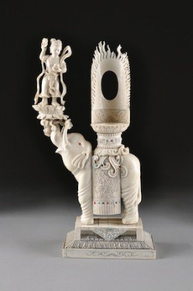 A VINTAGE CHINESE CARVED IVORY BUDDHISTIC ELEPHANT,