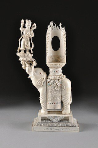 11: A VINTAGE CHINESE CARVED IVORY BUDDHISTIC ELEPHANT,