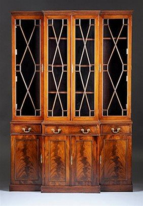 A GEORGE III MAHOGANY BREAKFRONT BOOKCASE CABINET,