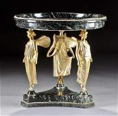 A CONTINENTAL NEOCLASSICAL STYLE GILT-BRONZE MOUNT