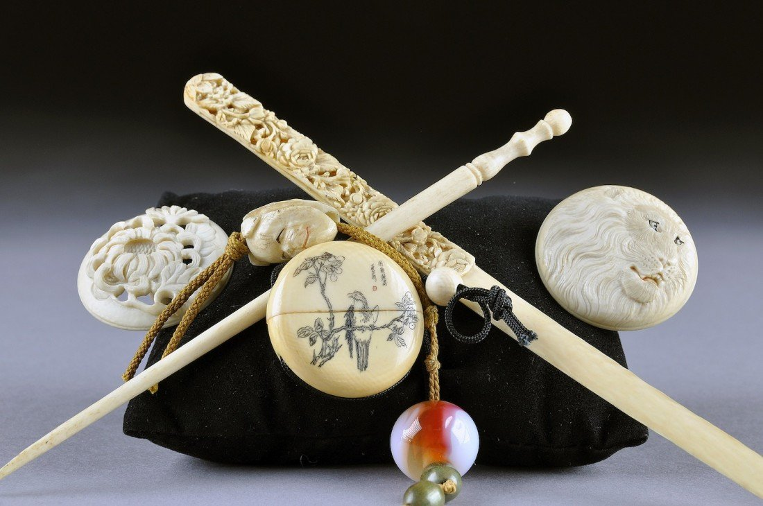 4: A GROUP OF SIX JAPANESE CARVED IVORY ACCESSORIES, 20