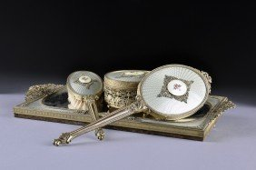 A VINTAGE FOUR PIECE LADY'S GILT METAL VANITY SET, M