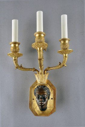 A RESTAURATION GILT AND PATINATED BRONZE THREE-LIGH