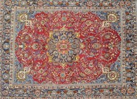 A MESHAD CARPET, THE PERSIAN RED FIELD Centering A