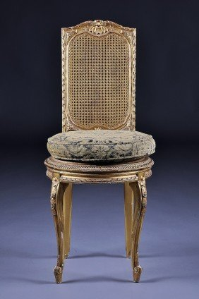 AN ANTIQUE FRENCH PARCEL-GILT AND CARVED WOOD CANE