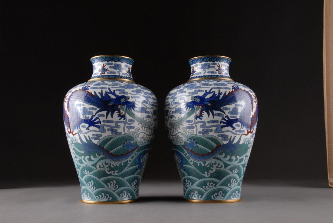 153: A PAIR OF VINTAGE CHINESE POLYCHROME ENAMELED CLOI