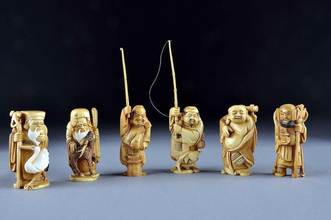 162: A SET OF SIX JAPANESE CARVED IVORY OKIMONOS OF IMM