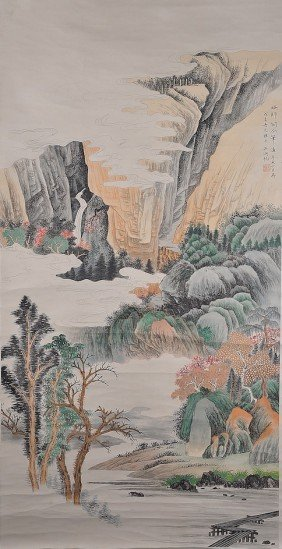 A CHINESE MOUNTAINSCAPE WATERCOLOR SCROLL PAINTING