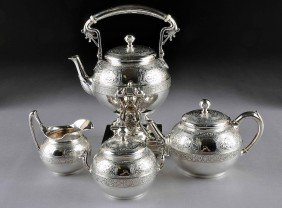 AN ANTIQUE FOUR PIECE TIFFANY & CO STERLING COFFEE