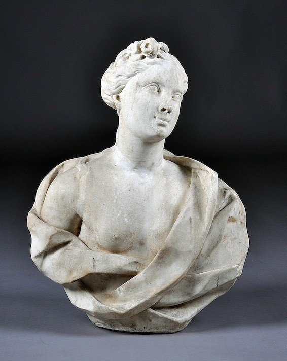 174: A CONTINENTAL CARVED WHITE MARBLE GARDEN BUST OF F