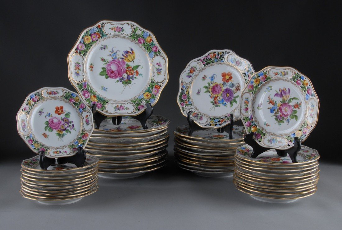 214: A FORTY-EIGHT PIECE DRESDEN RETICULATED DINNER SER