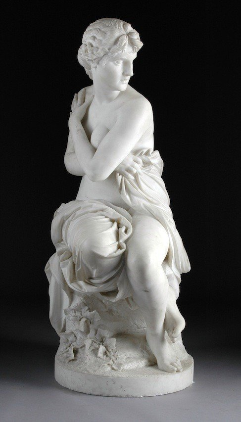 260: A CONTINENTAL CARVED WHITE MARBLE SCULPTURE OF VEN