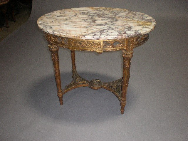 1H: A LOUIS XVI STYLE PARCEL GILT AND CARVED WOOD MARBL