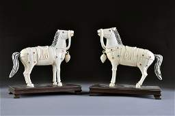 108: A PAIR OF VINTAGE CHINESE CARVED AND JEWELED IVORY