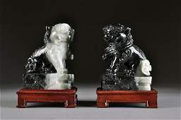217: A PAIR OF CHINESE CARVED WHITE AND BLACK JADE BUDD