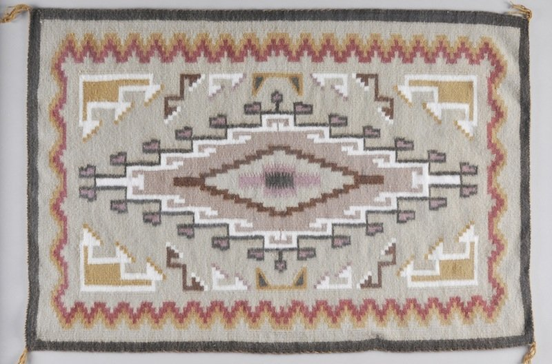 298: A NAVAJO INDIAN TWO GRAY HILL RUG, centering a dou