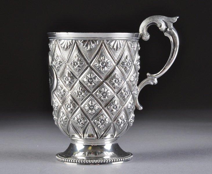 304: A VICTORIAN ENGLISH REPOUSSÉ STERLING CUP, MAKER'S