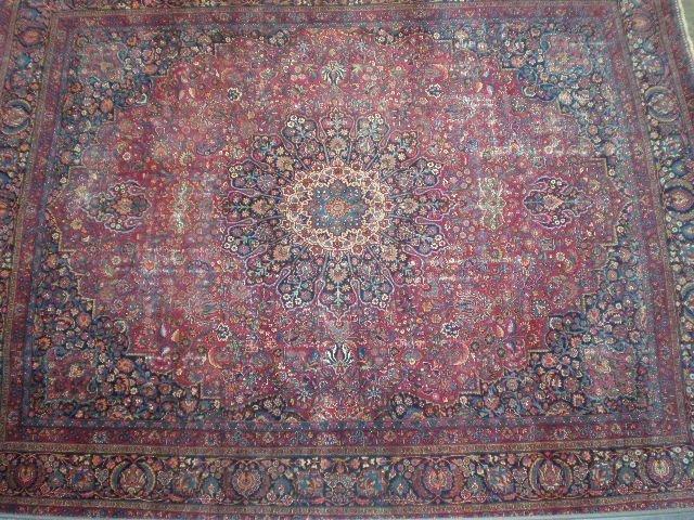 1R: A SAROUK CARPET, the Persian rose field centering a