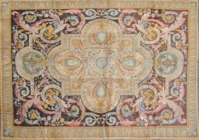 303: AN AUBUSSON STYLE CARPET, the maroon field centeri