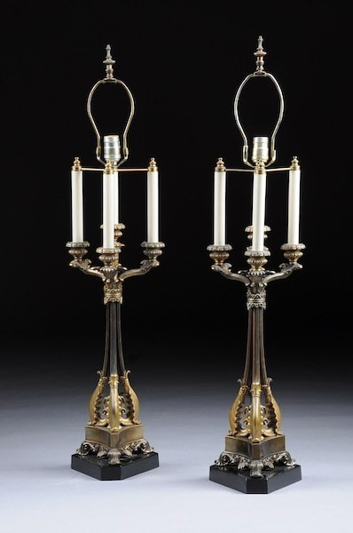 308: A PAIR OF EMPIRE STYLE GILT METAL FOUR-LIGHT CANDE