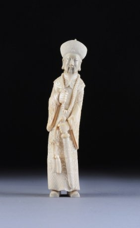 A VINTAGE CHINESE CARVED IVORY FIGURE OF AN EMPERO