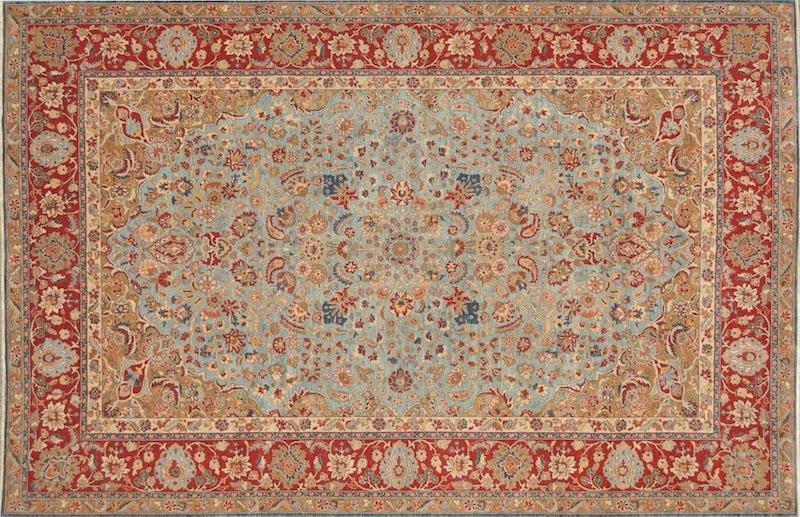 319: A FINE PERSIAN TABRIZ CARPET, the powder blue fiel