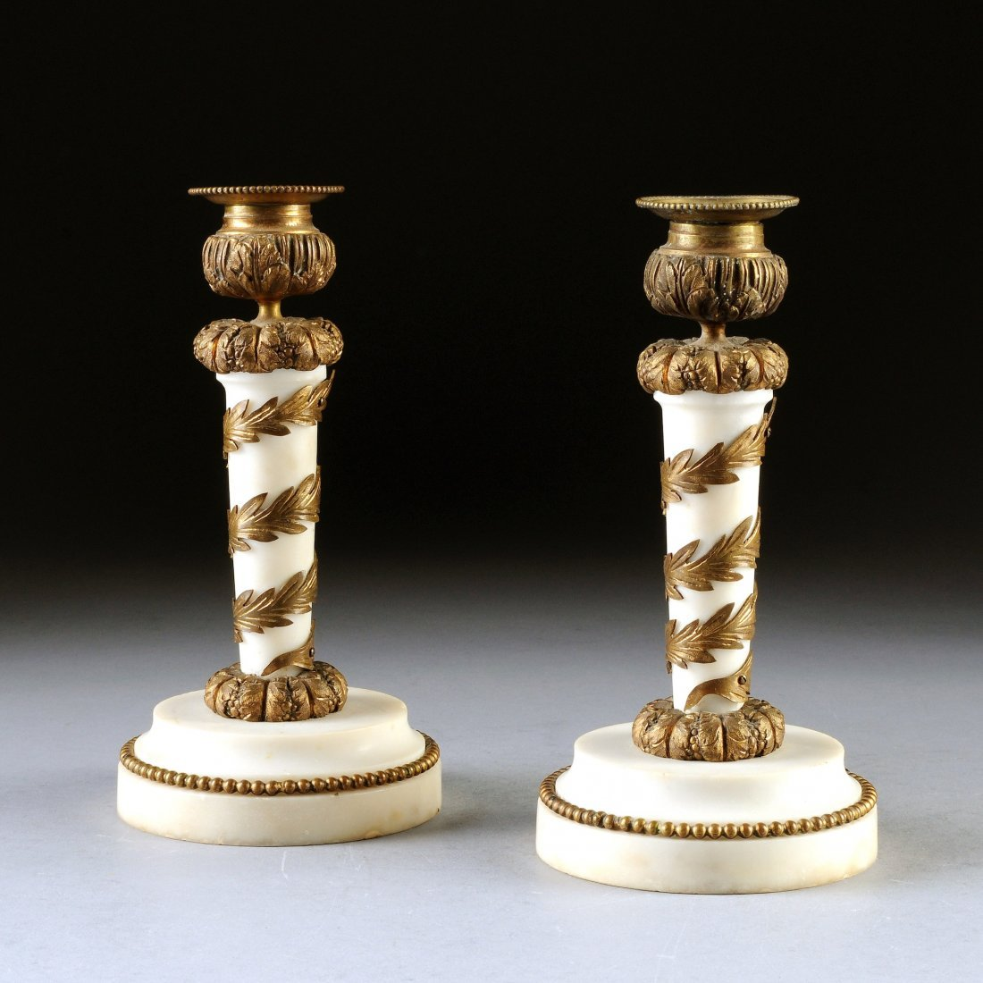 8:  A PAIR OF EMPIRE STYLE MARBLE AND GILT BRONZE CANDL