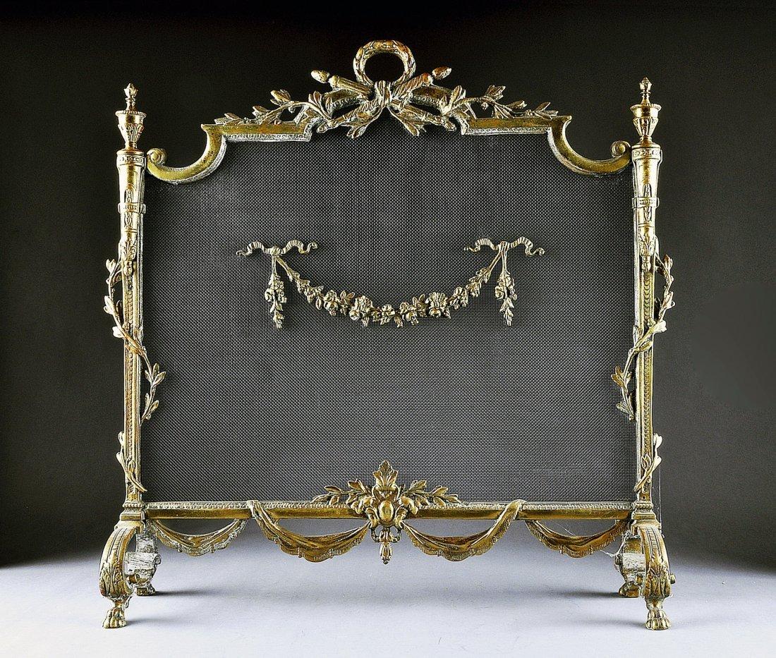 10:  A LOUIS XVI STYLE GILT BRONZE FIREPLACE SCREEN, EA