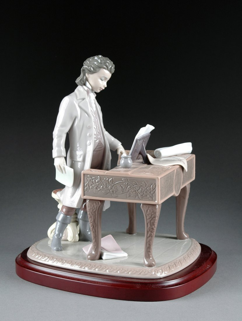 12:  A LLADRO PORCELAIN FIGURAL SCULPTURE OF A YOUNG BE