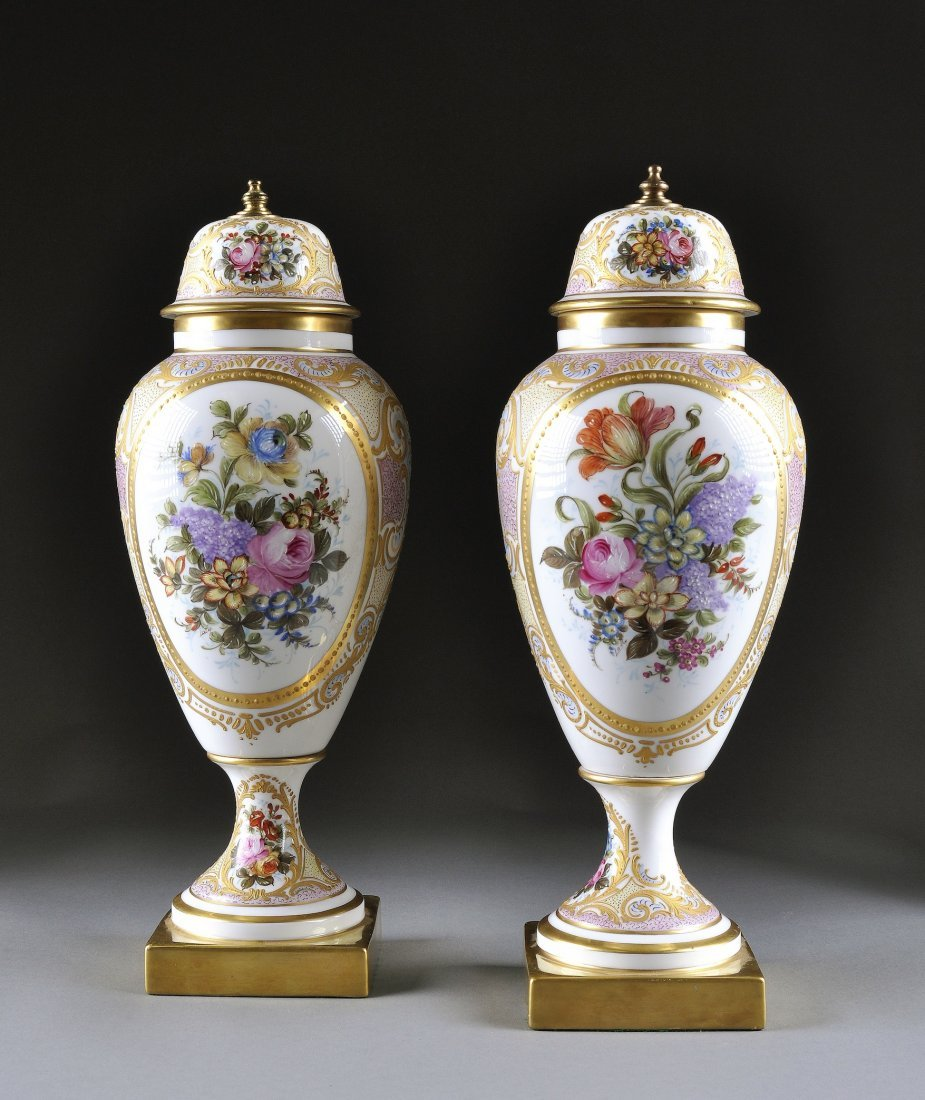 16:  A PAIR OF SÈVRES STYLE PARCEL GILT AND COLORFULLY