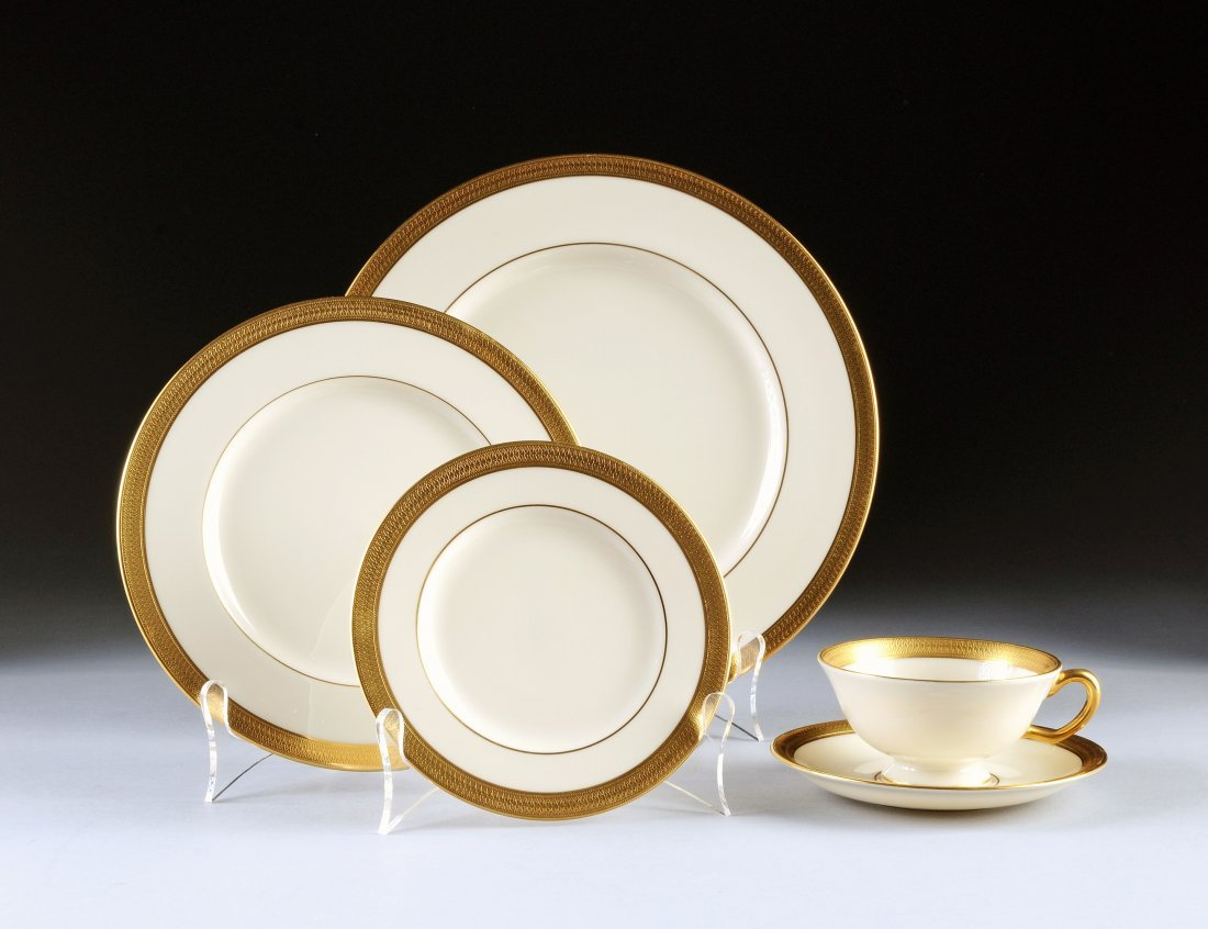 18:  A FORTY-EIGHT PIECE LENOX PARCEL GILT IVORY GROUND