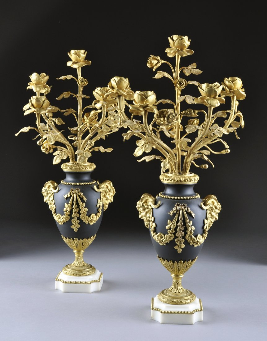 363:  A PAIR OF LOUIS XVI STYLE GILT AND PATINATED BRON