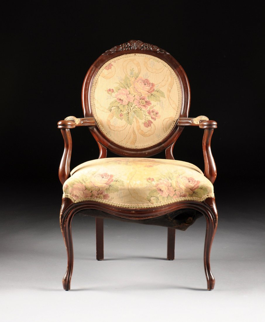 A ROCOCO REVIVAL STYLE CARVED MAHOGANY ARMCHAIR, EARLY