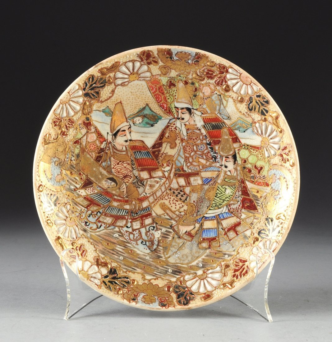 A MEIJI PERIOD SATSUMA PLATE, enameled in shades of cin