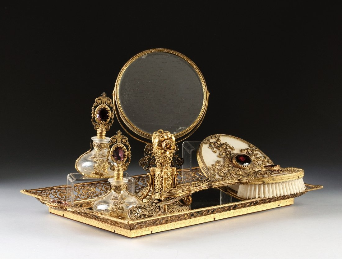 A SEVEN PIECE CONTINENTAL FAUX AMETHYST MOUNTED GILT ME